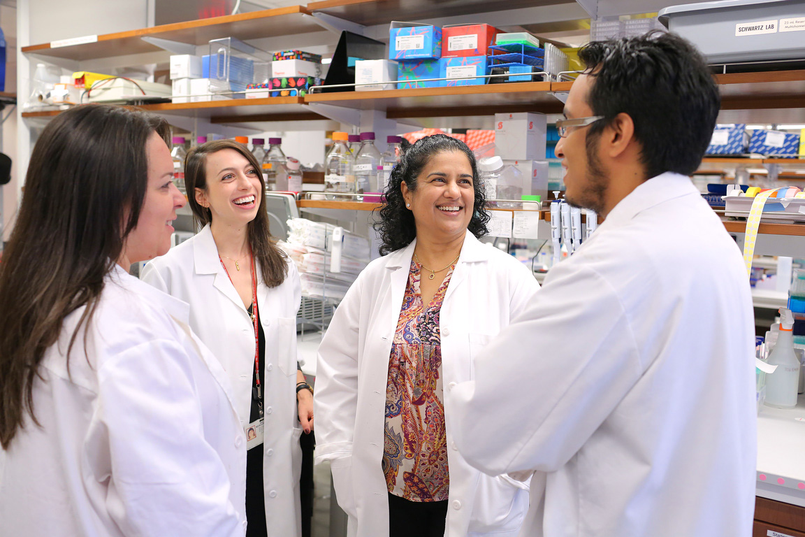 Dr. Anjali Rajadhyaksha and some of her lab team