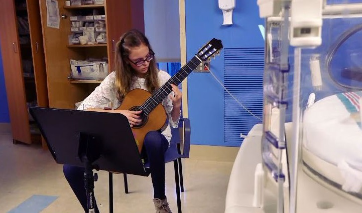 Former patient giving the gift of music in the NICU