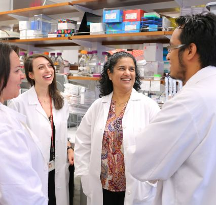 Dr. Anjali Rajadhyaksha and some of her lab team