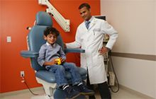 Child patient in doctor's chair.